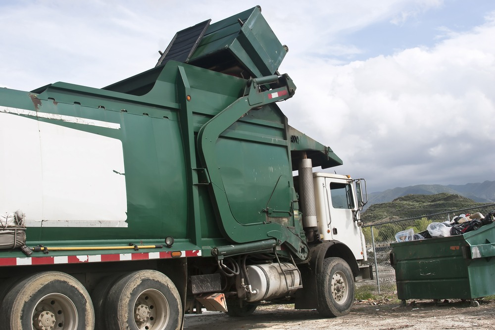 To prevent a dumpster truck from overturning